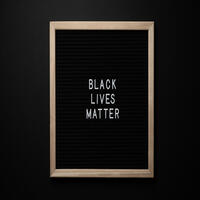 A sign that says Black Lives Matter
