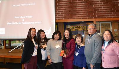Sunny Low Award Recipient, Sunny Lee, posing with Sunny Low's Family and APASA leadership